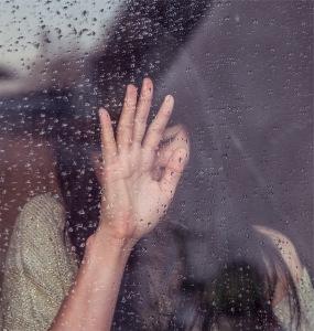 crying woman in the rain